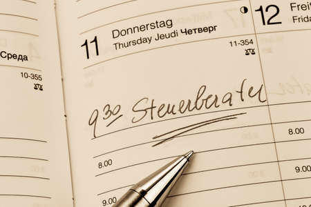 auditors: an appointment is entered on a calendar: accountants