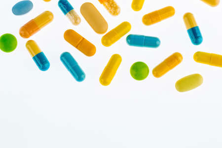 many tablets are on a light background. symbol photo for medicine and drugs in the pharmaceutical industry