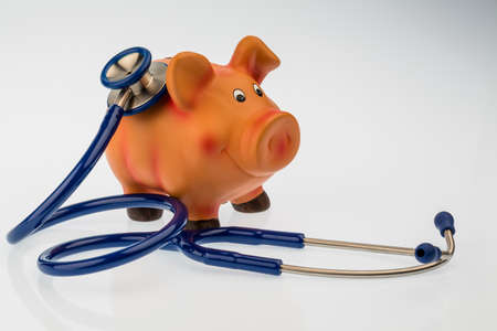a piggy bank and a stethoscope. symbol photo for save in the doctors office and safe investment