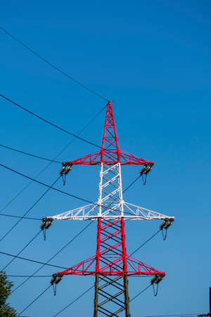energy needs: pylon red and white, symbolizing power, power supply, electromagnetic pollution