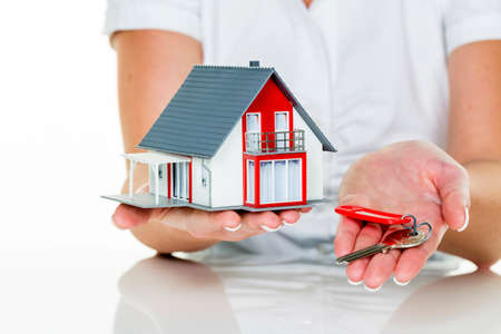 an agent for property with a house and a key. successful leasing and property sales by real estate brokers. Stock Photo