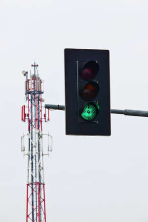 a mobile radio mast and green traffic light. network will be further expanded