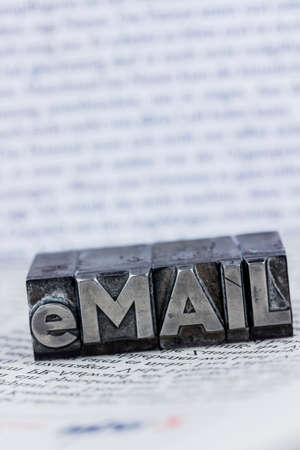 the word e-mail in lead letters written. symbol photo for quick correspondence Stock Photo