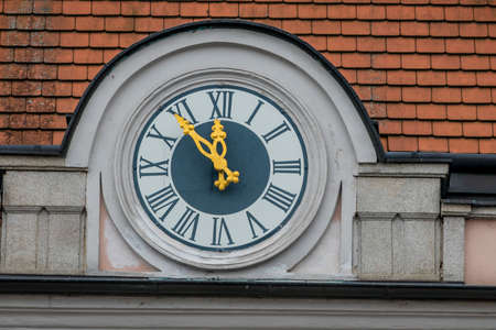 municipalities: clock on the facade, symbolizing an empty treasury in municipalities and communities. 5vor12 for municipal budget