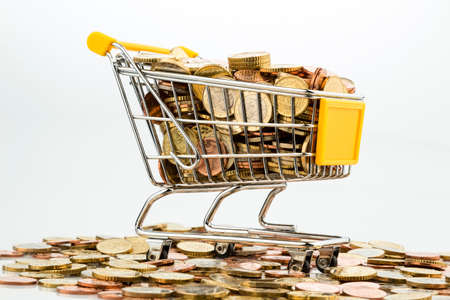 a shopping cart is well stocked with euro coins, symbol photo for purchasing power and consumption