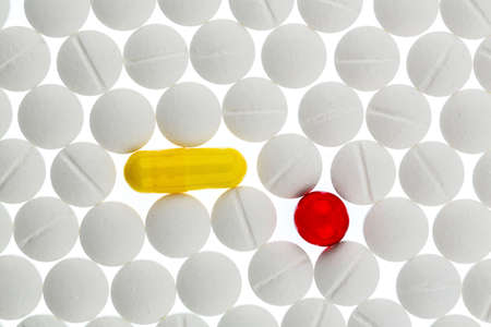 white and colored tablets symbolfoto for medicines, remedies and painkillers Stock Photo