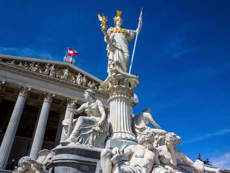 parliament in vienna, austria. with the statue of the pallas athene the greek goddess of wisdom.