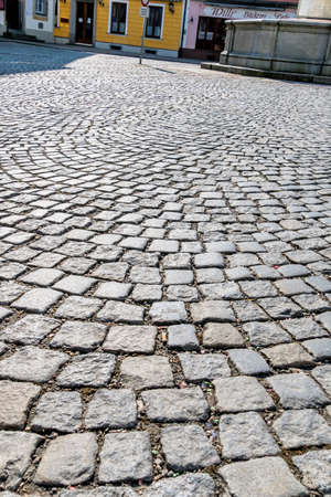 infrastructures: paving stones in pedestrian area, symbol of road construction, structure, background