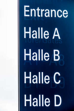 informing: sign to the inputs of the vienna exhibition hall. Stock Photo