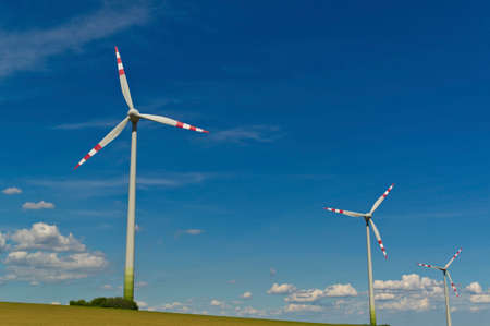 energy needs: wind turbine of a wind power plant for electricity Stock Photo