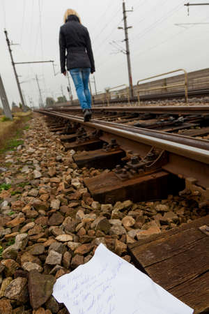 psychologically: woman goes in suicide intent on a track