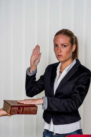 juror: woman swears on the bible