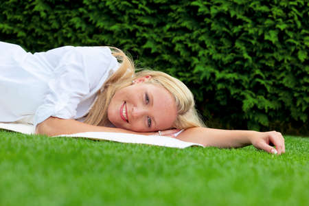 woman lying to rest in the meadow Stock Photo