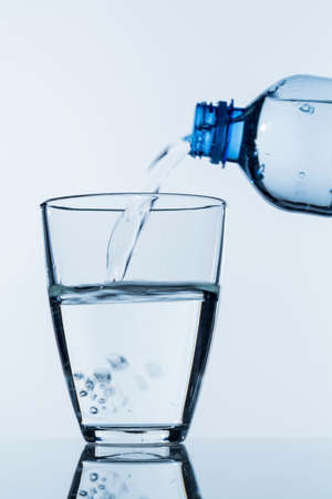 pour water into a glass Stock Photo
