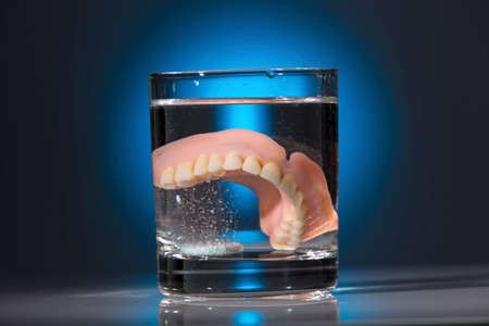 dentures in a teacup