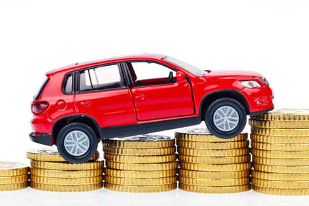 model car and coins. car costs Stock Photo