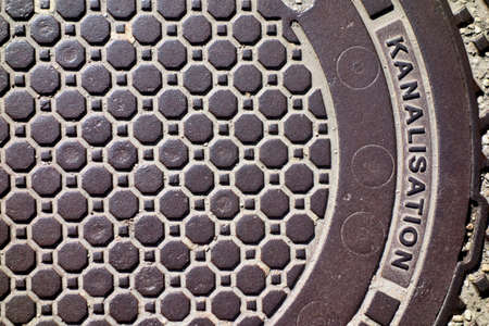derivation: cover of a sewer