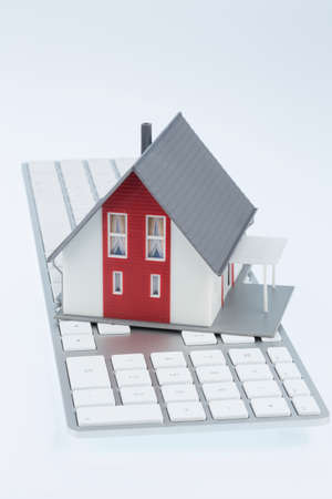 single familiy: residential house on keyboard