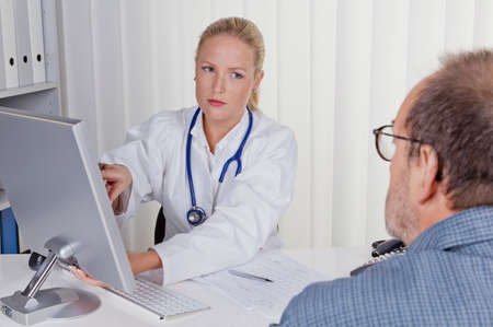 doctor with stethoscope talking with patient photo