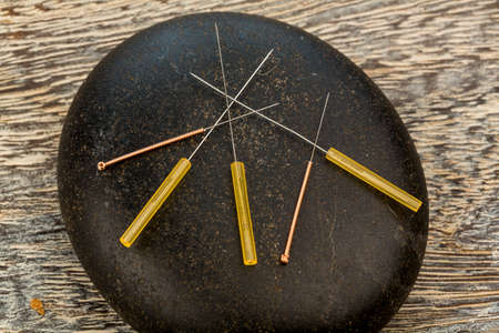 naturopaths: acupuncture needles Stock Photo