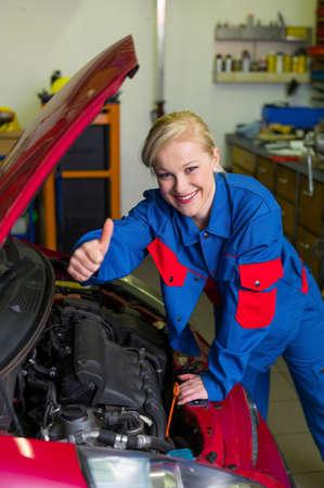 woman as a mechanic in auto repair shop photo
