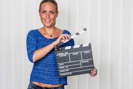 synchronously: woman with clapperboard