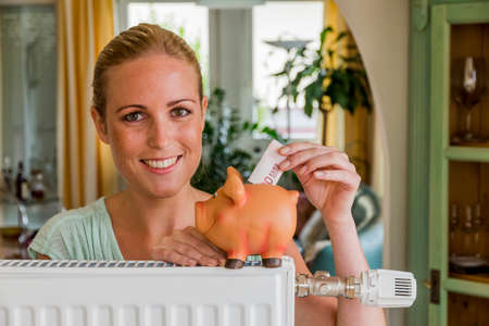 woman with radiator and piggy bank