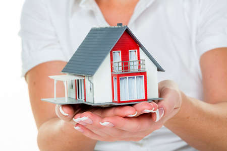 real estate agent with house and schlü�el Stock Photo