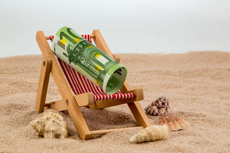 deckchair with euro banknote