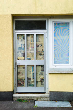 tristesse: shop door taped with paper,