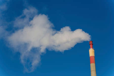industrial chimney with exhaust gases Stock Photo