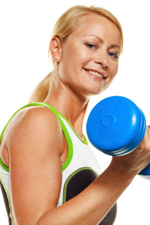 woman with dumbbells during training for strength photo