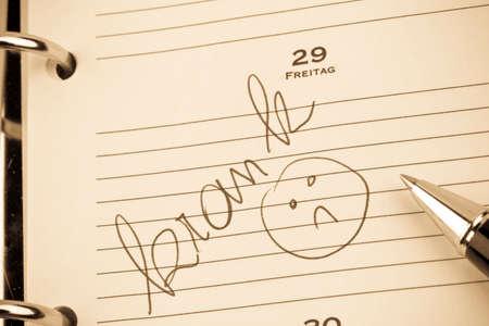 Inschrijving in de kalender: ziek Stockfoto - 79478346