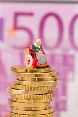 nursing allowance: woman in wheelchair on money stack