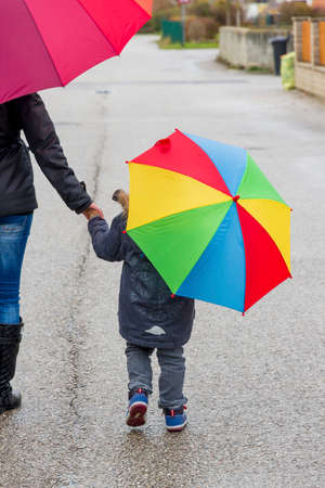 mother and child with umbrella Stock Photo