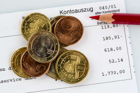 bank statement: bank statement and coins
