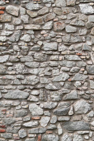 a stone wall as background Stock Photo