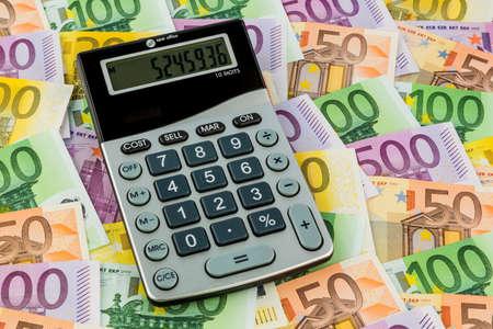 calculator and euro bills