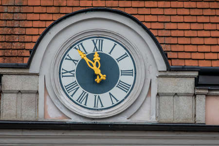 clock at the town hall, symbol of empty coffers in the municipalities and municipalities. 5vor12 for the community budget
