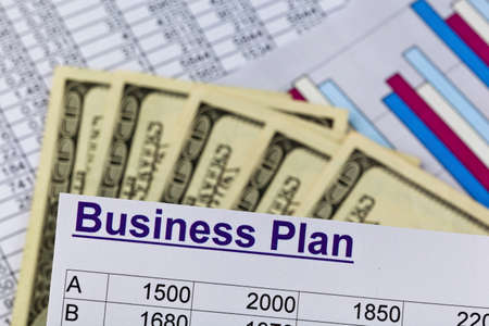 a business plan to start a business. ideas and strategies for starting a business. dollars and calculator