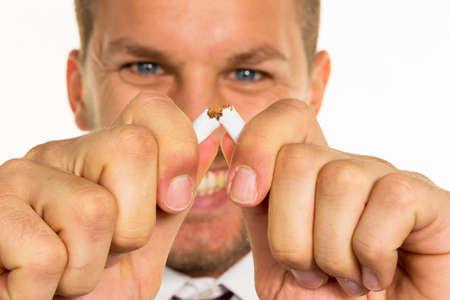 man breaks cigarette