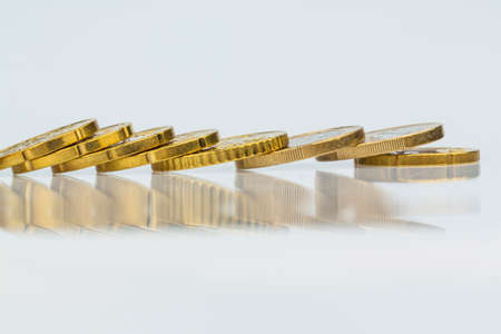 lying coins in a row Stock Photo