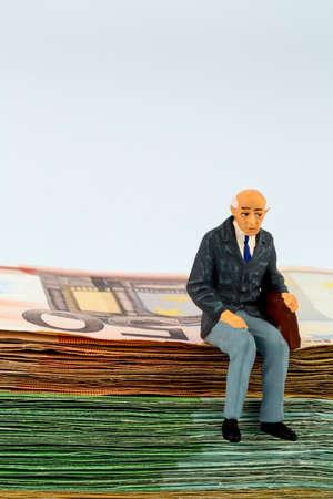 senior is sitting on bills Reklamní fotografie