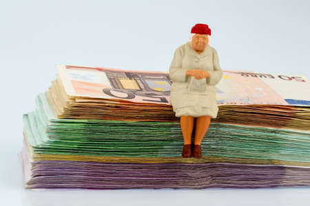 senior woman sits on bills