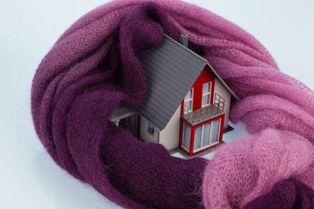 house with scarf. symbolfoto heat insulation