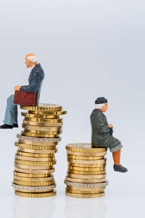 Pensioner  are sitting on piles of money Stock Photo