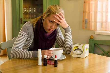 woman has a cold. river season Stock Photo