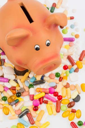pills and piggy bank