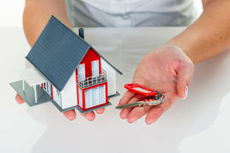 real estate agent with house and key Stock Photo