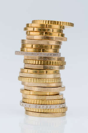 stack of coins in front of white background Stock Photo